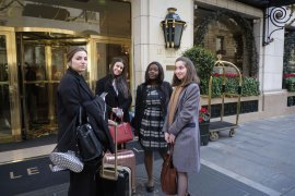 Students with their suitcase in front of luxury hotel Le Bristol