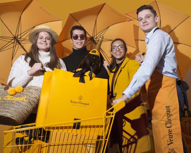 Students dressed in the color of Champagne house Veuve Cliquot